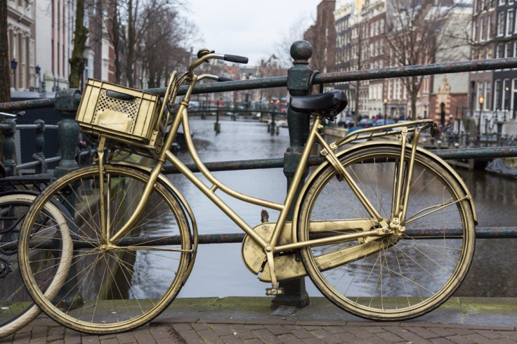 """Golden"" bike along canal - Amsterdam, The Netherlands"